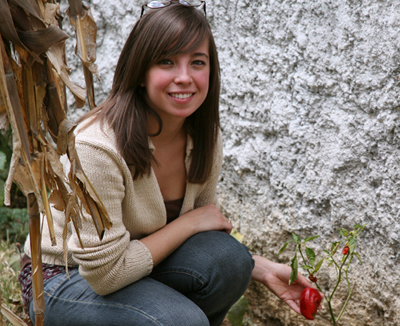 Ximena Jop with the Chile Pimiento in the garden, FLAAR Mesoamerica Staff