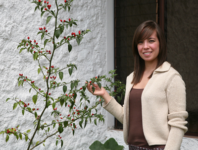 Ximena Jop with Chile in the garden, FLAAR Mesoamerica Staff