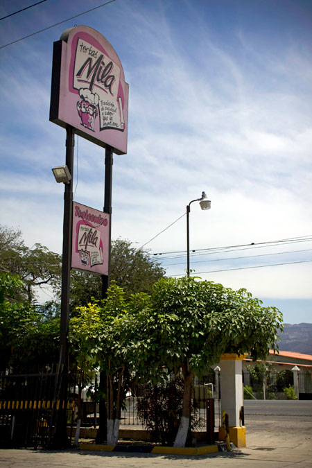 Tortas Mila road Entrance sign