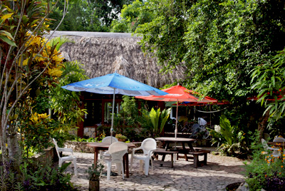 Outdoor tables of the Hotel Jaguar Inn Tikal