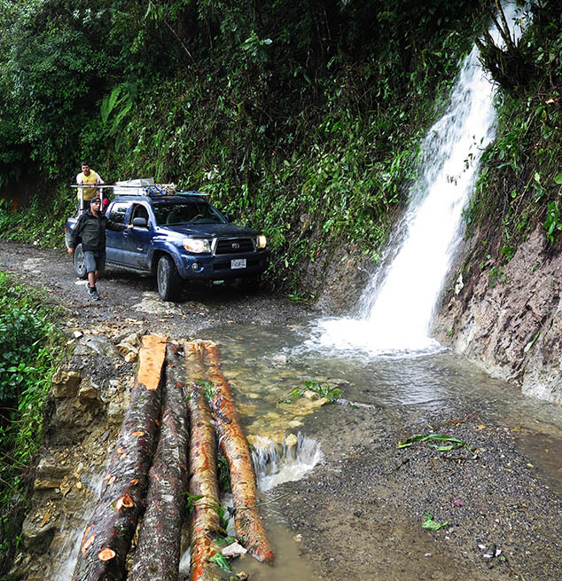 on our way to the Yaxlik Cave, logs used to fix the road, Alta Verapaz