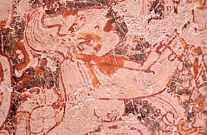 Naked woman on rollout of polychrome Mayan vase.