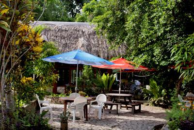 Outdoor Tables Of The Hotel Jaguar Inn Tikal