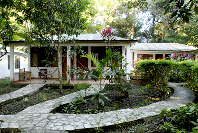 The Rooms Of Hotel Jaguar Inn Tikal Have A Beatiful Entrance With Flowers And Plants